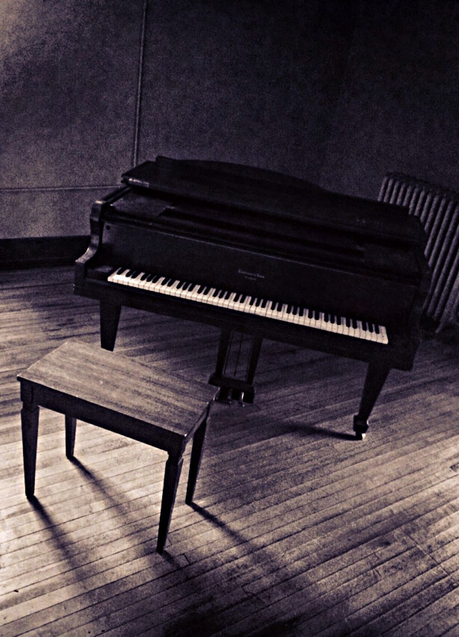 High Angle View Of Piano And Table On Floor At Home