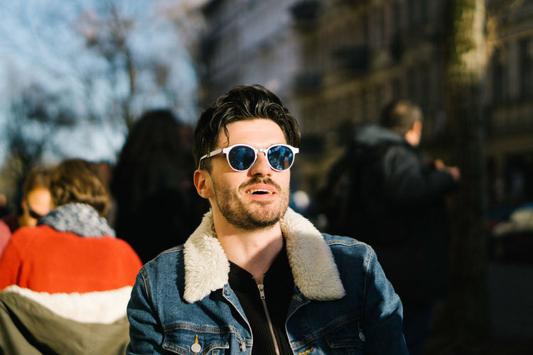 Handsome man wearing sunglasses in city