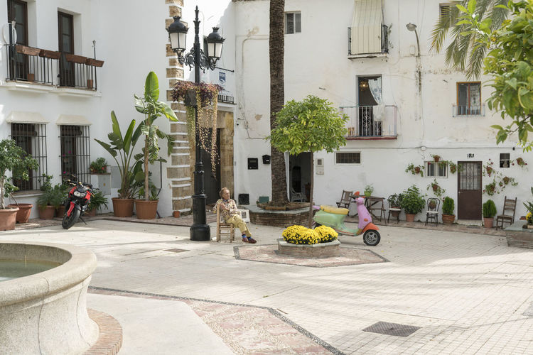 Marbella MarbellaOldTown Old Town SPAIN Architecture Spanish Architecture Holiday Destination Vibrant Color Building Exterior Built Structure Street Building Transportation Mode Of Transportation Residential District Day Motor Scooter Plant Real People Scooter Men Incidental People People Outdoors Taking A Break