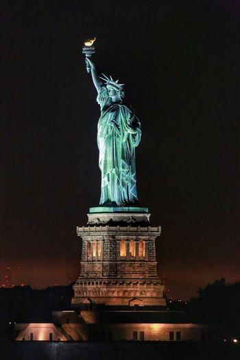 Arriving in New York Statue Female Likeness Human Representation Travel Destinations Sculpture Night Illuminated