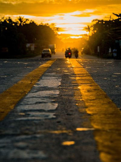 Street in city during sunset