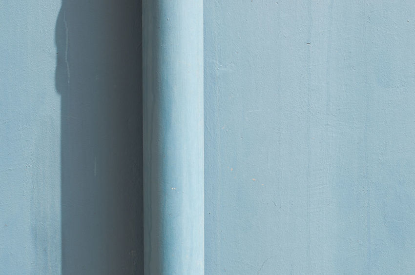 Urban close up of a light blue rainwater pipe against the same colour wall, with a shadow. City Singapore Wall Abstract Architecture Backgrounds Blue Built Structure Close-up Day Downspout Drainpipe No People Pipe Powder Blue Shadow Urban Colour Your Horizn