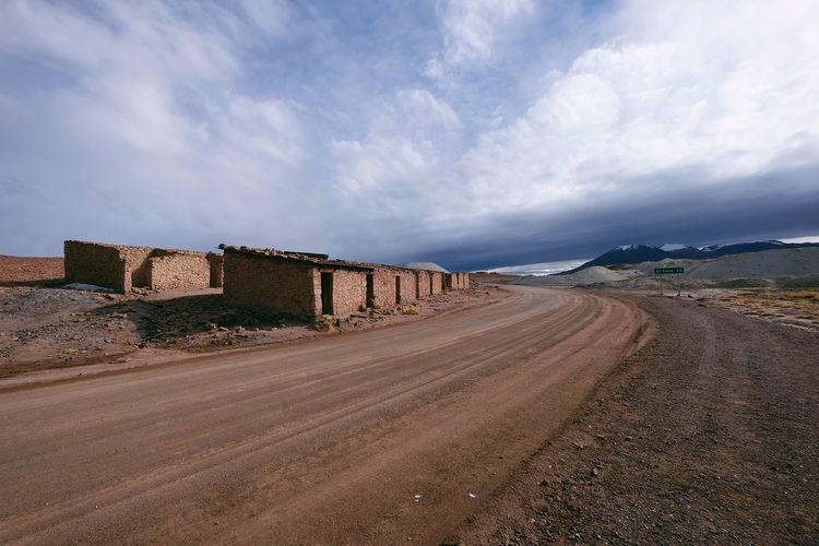 The road to El Tatio Storm Cloud Dirt Road Empty Building Abandoned El Tatio Chile Atacama Desert Landscape Outdoors Day Cloud - Sky No People Sky