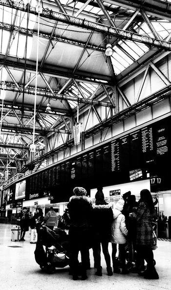 busy busy London station Photowalktheworld People Busy Surreal Black And White Travel Waiting Waiting For A Train Group Of People Men Full Length Sitting Women Street Scene Subway Platform Railway Station Platform International Landmark Rail Transportation
