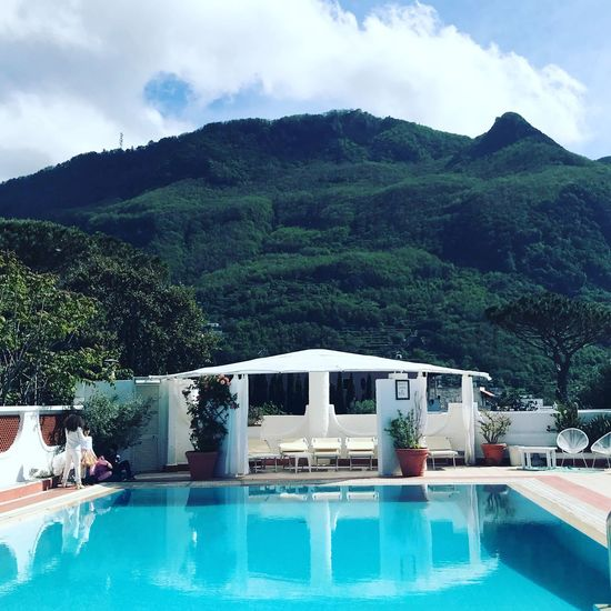 View of swimming pool with mountain in background