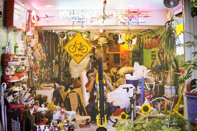 Abundance Bicycle Shop Bicycles Bikes Display Film Is Not Dead Film Photography Filmisnotdead Filmphotography For Sale Guy Hanging Large Group Of Objects Looking At Camera Market Neon Sign Retail  Shop Sign Signs Store