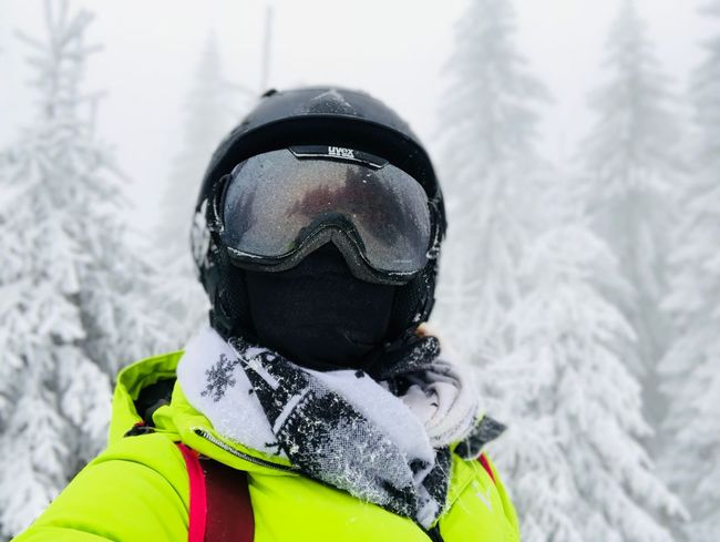 Selfie of woman wearing Uvex helmet and frozen Uvex ski glasses with forest of evergreen trees in the background Evergreen Forest Fog Cold Ski Glasses Frozen Skier Selfie Face Woman Snow Winter Cold Temperature Adventure Ski Goggles Mountain Exploration Day One Person Real People Headwear Leisure Activity Snowing Ski Holiday Warm Clothing Vacations Nature Sports Helmet Lifestyles Sport