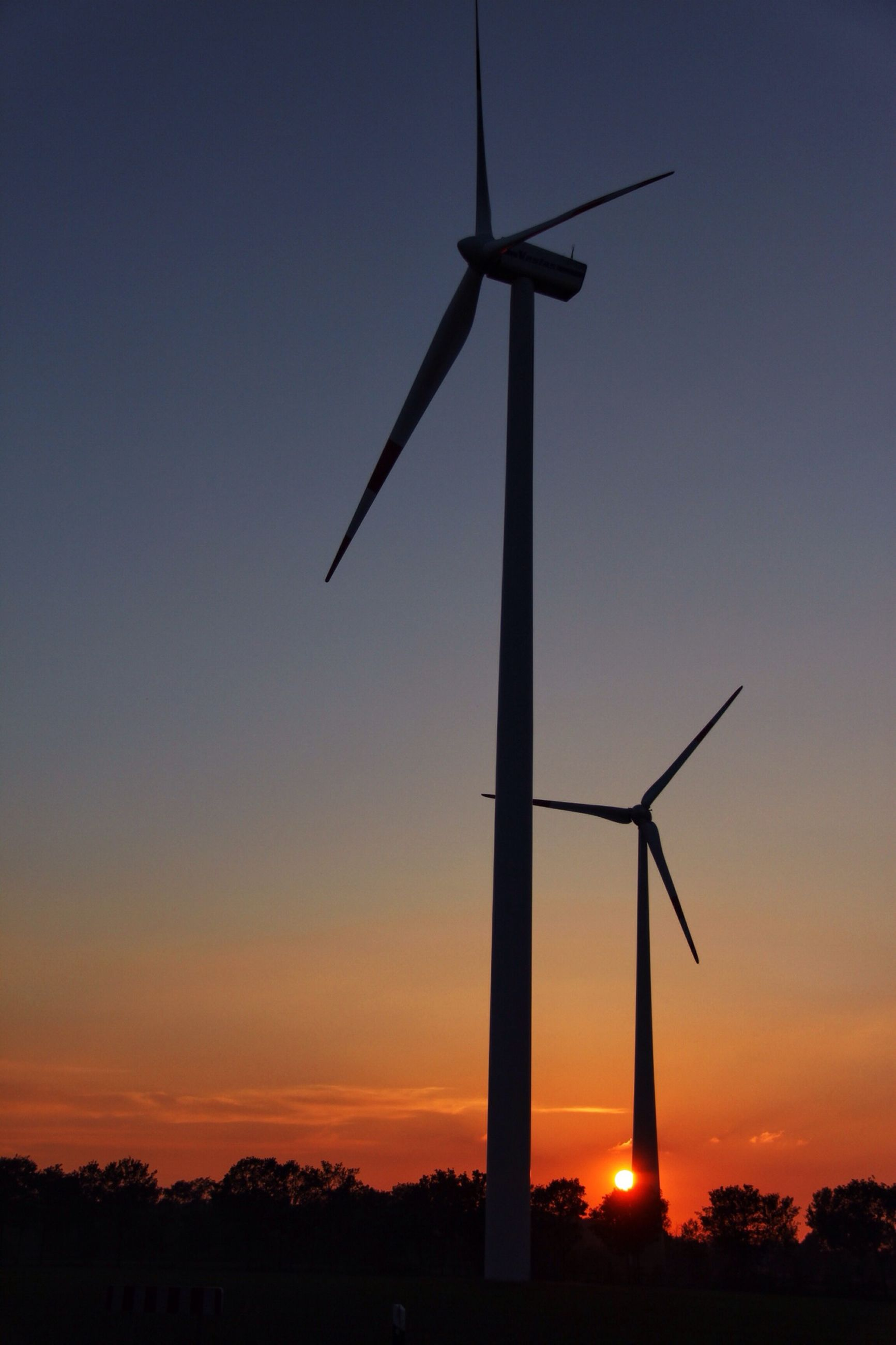 sunset, wind turbine, windmill, alternative energy, wind power, renewable energy, environmental conservation, fuel and power generation, silhouette, traditional windmill, sky, sun, orange color, landscape, rural scene, technology, field, nature, outdoors, religion