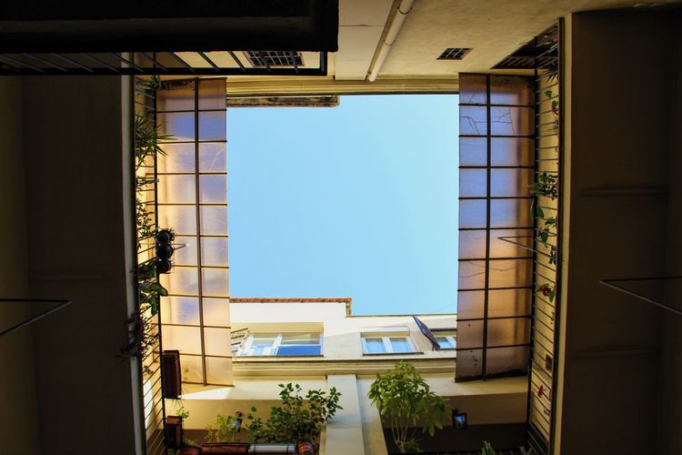 [ Appia Nuova ] The interior of an exterior. Architecture Blue Sky Building Exterior Contrast Exterior Glass Glass - Material Home Indoors  Italian Architecture Light Light And Shadow Light In The Darkness Low Angle View Residential District Residential Structure Roman Architecture Showcase March Transparent Window Windows Interior Views Urban Geometry Urban Landscape Cityscapes