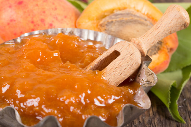 Apricot Jam With Wooden Spoon In Plate