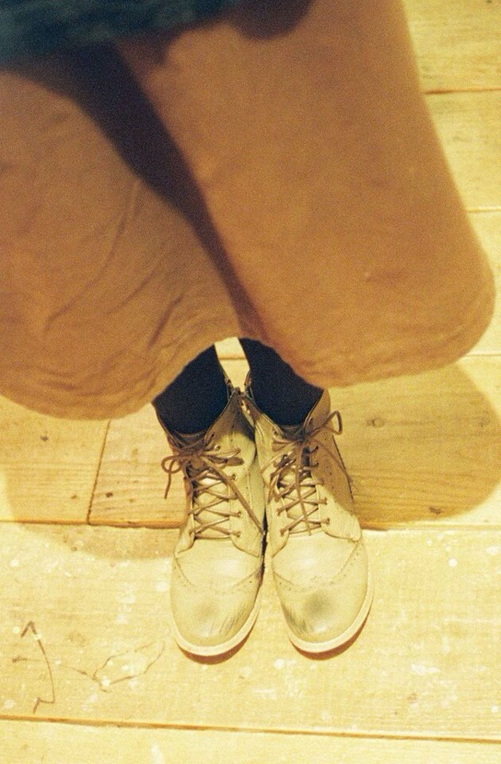 indoors, shoe, low section, high angle view, wood - material, person, table, still life, standing, footwear, close-up, fashion, wooden, hardwood floor, flooring, brown, pair, shadow