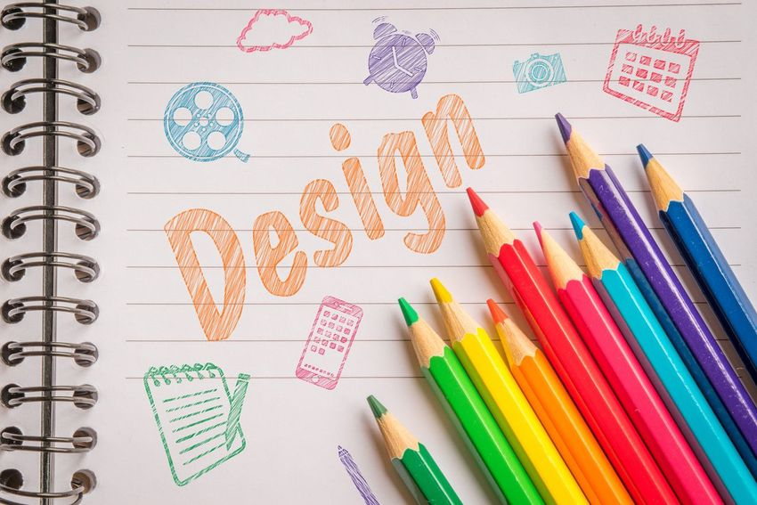 Colorful pencils on a notebook with doodle design Graphics Graphic Design Paper Notebook Colors Creativity Creative Drawing Doodles Design Pencil Paper Education Crayon No People Indoors  Childhood Day