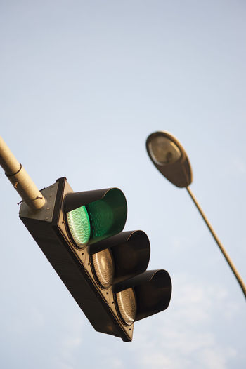 Close-up shot of traffic lights against the clear sky. City Clear Sky Close Up Close-up Day Direction Green Information Isolated Lamp Lamp Post Low Angle View No People Outdoor Outdoors Road Safety Signal Sky Sky And Clouds Stoplight Technology Traffic Traffic Lights Traffic Sign