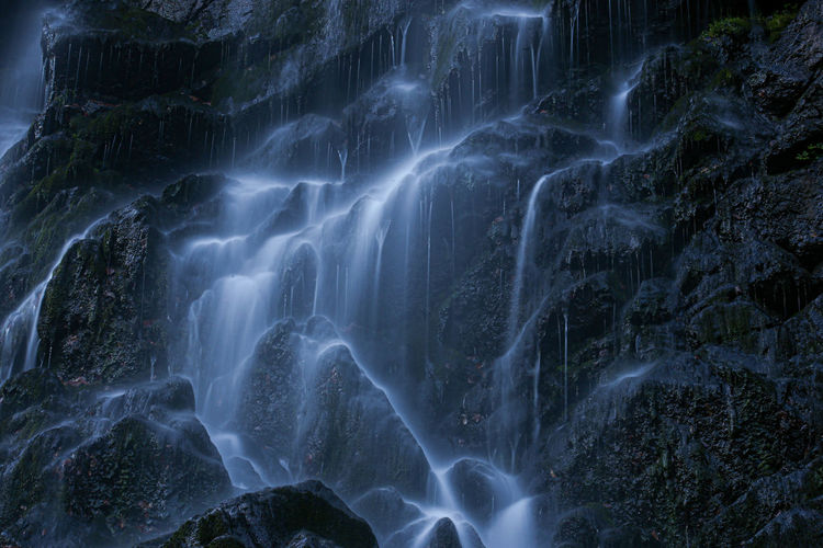 Full frame shot of waterfall in forest