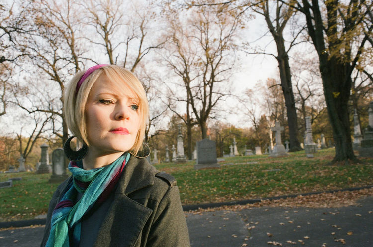 35mm Film Analogue Photography Autumn Bare Tree Blonde Casual Clothing Cemetery Photography Day Faces Of EyeEm Grass Leisure Activity Lifestyles Looking At Camera Outdoors Park Park - Man Made Space Person Scarf She Walks In Beauty Tree Woman Portrait Women Of EyeEm Women Who Inspire You Eyes