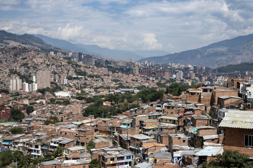 Slums Colombia Medellin City Medellín Architecture Building Exterior Built Structure City Cityscape Cloud - Sky Community Comuna 13 Comunas Environment Mountain Mountain Range Outdoors Poverty Residential District Sky Slums TOWNSCAPE