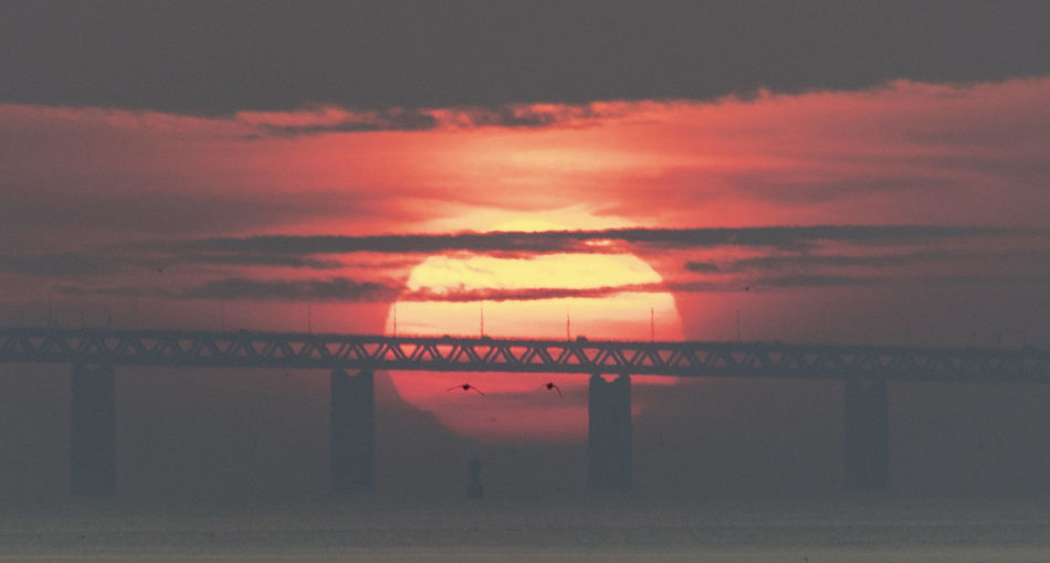 Sunset behind bridge Sky Cloud - Sky Sunset Beauty In Nature Water Built Structure Architecture Horizon Over Water Bridge Over Water Horizon