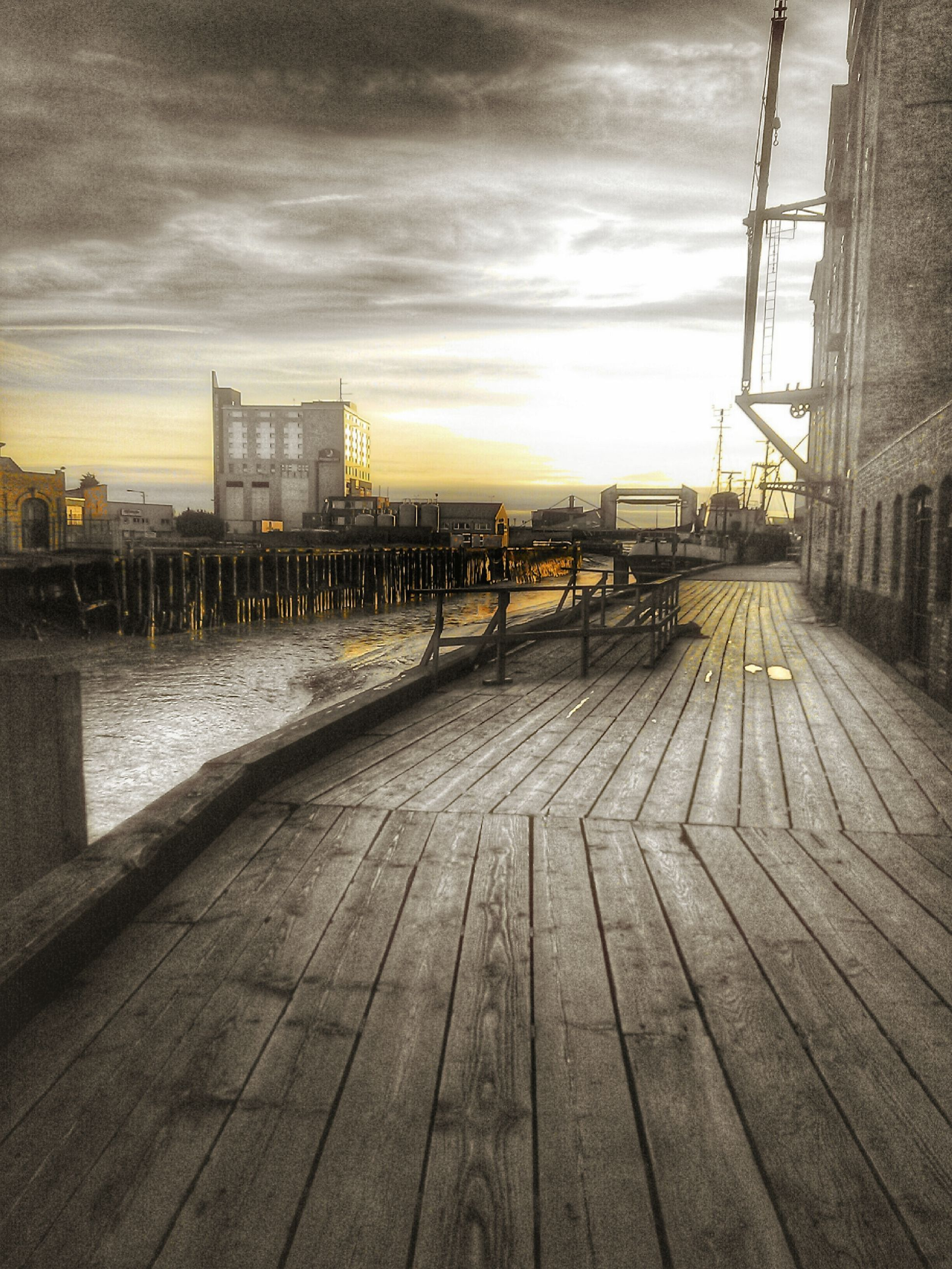 built structure, architecture, sky, building exterior, water, cloud - sky, city, pier, wood - material, the way forward, boardwalk, cloud, cloudy, sunset, river, railing, sea, outdoors, diminishing perspective, no people