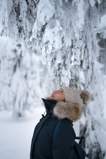 Close-up of woman standing on snow