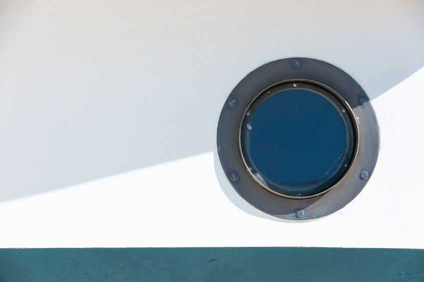 Full frame shot of white and turquoise ship exterior with porthole Part Of Porthole Sunny Transportation Turquoise Colored Blue Circle Close-up Copy Space Day Full Frame Geometric Shape Glass - Material Metal Nautical Vessel No People Outdoors Shadow Shape Ship Single Object Still Life Sunlight White Color Window