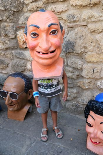 Playing whit a mask Smiling Real People Day Portrait Full Length People Child Looking At Camera Happiness Men Standing Family Females Casual Clothing Emotion Representation Leisure Activity Stone Wall Playing Mask Capgrossos Catalonia