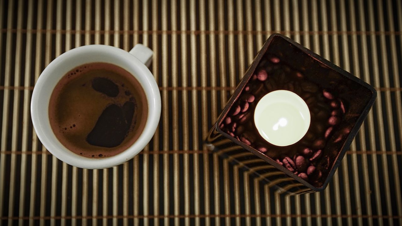 HIGH ANGLE VIEW OF COFFEE CUP ON TABLE WITH SPOON