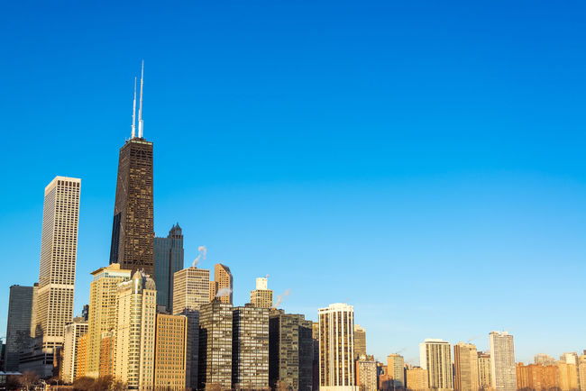 View of Chicago skyscrapers with a beautiful deep blue sky Architecture Building Building Exterior Buildings Built Structure Chicago Chicago Architecture City Cityscape Colorful Destination Downtown Downtown Chicago Frozen Hancock HancockTower Horizon Illinois Lake Landmark Modern Office Building Outdoors Panoramic Winter