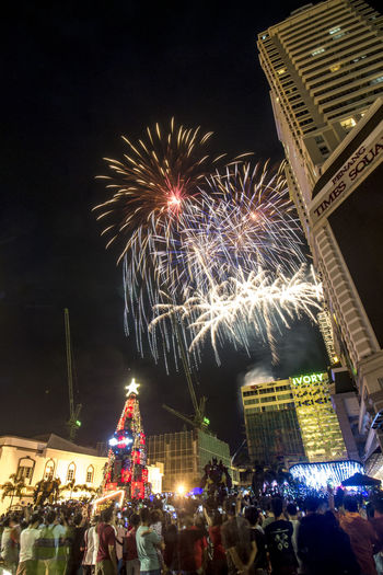 2018 new year eve count down, and fireworks. Happy New Year 2018. Architecture Arts Culture And Entertainment Building Exterior Built Structure Celebration Celebration Event City Crowd Enjoyment Event Exploding Firework Firework - Man Made Object Firework Display Illuminated Large Group Of People Leisure Activity Lifestyles Low Angle View Men Motion Night Outdoors Real People Women