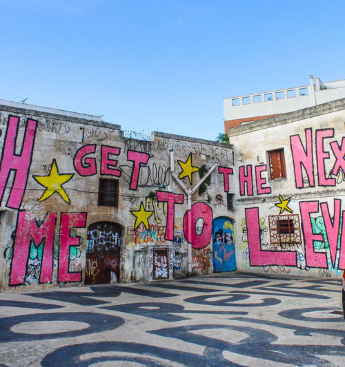 EyeEm Best Shots EyeEmNewHere Eye4photography  Street Multi Colored Street Art Text City Orthographic Symbol Spray Paint Graffiti Communication Sky Architecture Mural Paintings Written Capital Letter Fine Art Painting Art