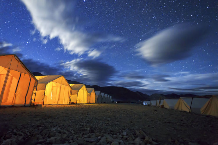Tented tourist camps at Pangong Lake in Ladakh, India. Ladakh is the highest plateau in the state of Jammu & Kashmir, with much of it being over 3,000m. ASIA India Ladakh Top Architecture Astronomy Beach Beauty In Nature Camping Cloud - Sky Galaxy Himalaya Kasmir Leh Nature Night Outdoors Panggong Lake Shelter Sky Star - Space Tent Tented Camp Travel Destinations Water