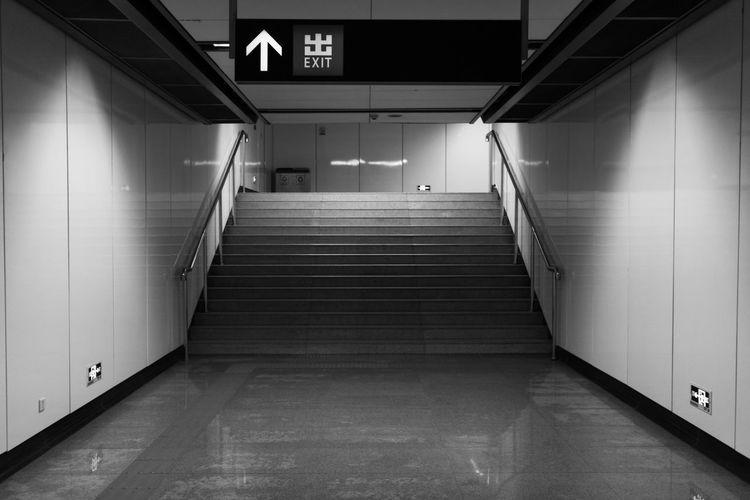 Illuminated walkway at subway station
