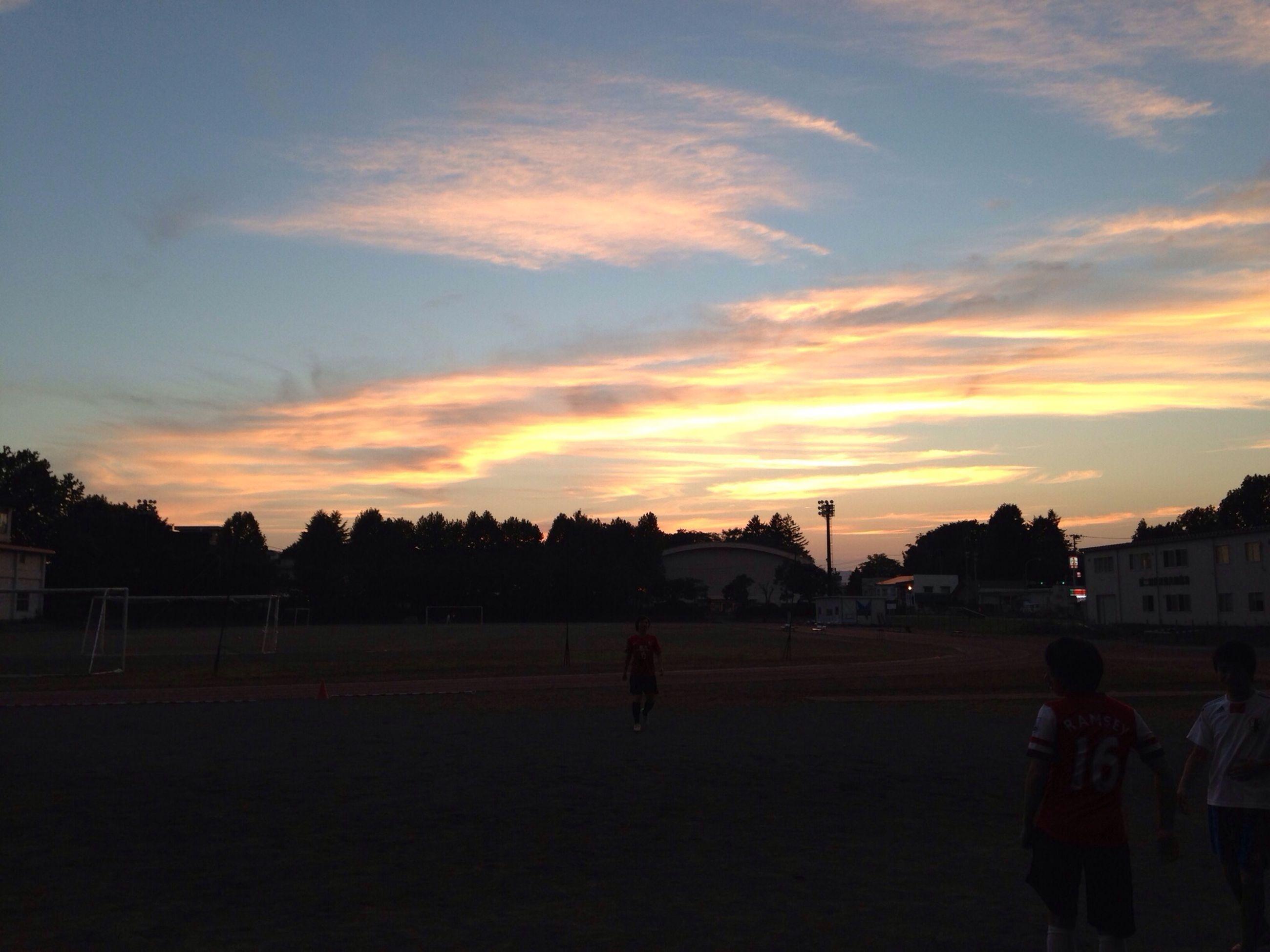 sunset, sky, lifestyles, men, silhouette, leisure activity, orange color, walking, person, cloud - sky, transportation, rear view, full length, street, outdoors, cloud, building exterior