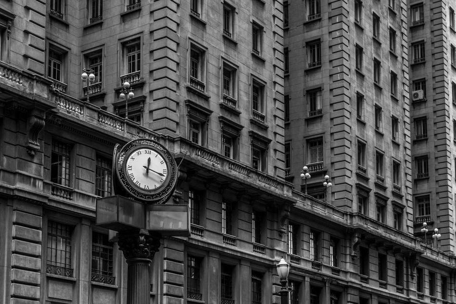 Black and white iconic old style street clock in front of buildings with windows with old street lamp posts in downtown area of São Paulo, Brazil, one of the biggest cities in the world. Architecture BIG Black And White Building Business City Clock Downtown Facade Building Hour Hurry Iconic Late Metropolis Minute Old Pace Schedule Second Stress Time Timing Town Urban EyeEmNewHere
