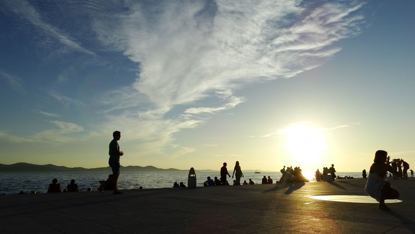 Summer In The City Adult Beach Beauty In Nature Cloud - Sky Crowd Group Of People Land Large Group Of People Leisure Activity Lifestyles Men Nature Outdoors Real People Sea Sky Sunset Water Women