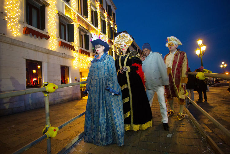 Carnival Carnival In Venice Refugee Venice, Italy Architecture Building Exterior Built Structure Carnival Masks Celebration City Full Length Illuminated Mask - Disguise Men Night Outdoors People Real People Sky Standing Togetherness Venetian Event Venetian Masks