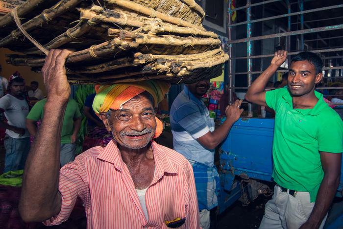 Dambulla market in Sri Lanka is the biggest food market on island Buy Casual Clothing Dambulla Day Enjoyment Farmer Farmers Market Fruits Fun Heavy Leisure Activity Lifestyles Market Outdoors Portrait Sell Seller Sri Lanka Traditional Clothing Vegetables