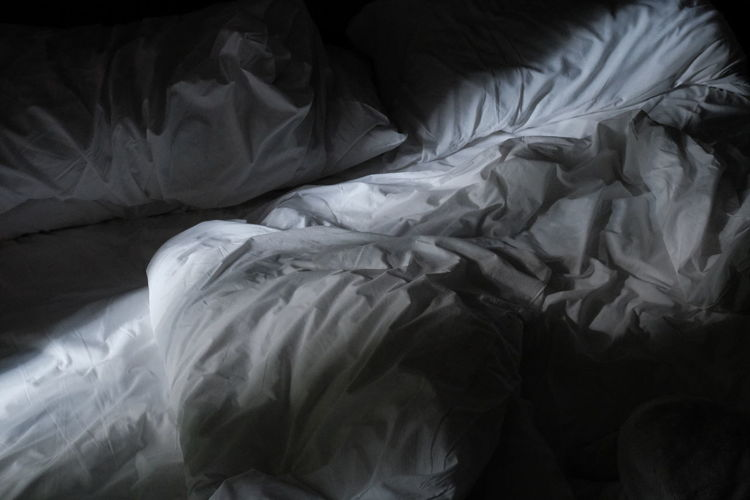 High angle view of messy bed