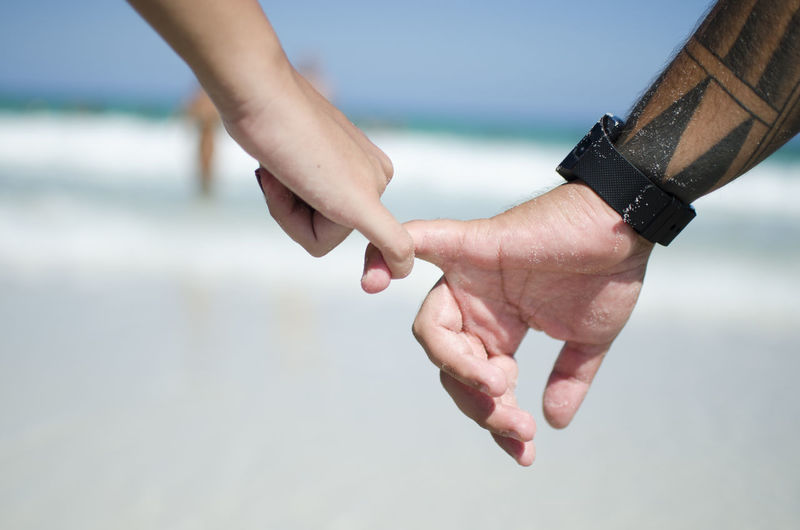 Human Hand Human Body Part Hand Body Part Two People Focus On Foreground Adult People Men Human Finger Finger Leisure Activity Real People Day Sea Lifestyles Water Holding Hands Togetherness Outdoors Couple - Relationship Human Limb Love Couple