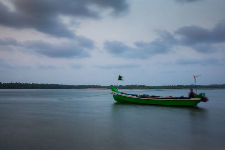 Beach Beauty In Nature Calicut Cloud - Sky Day Dramatic Sky Fishing Fishing Boat Gondola - Traditional Boat Harbor Kadalundi Kerala Landscape Long Exposure Longexposure Nature Nature Photography Nautical Vessel No People Outdoors Sea Sky Sony India Sonyalpha Water