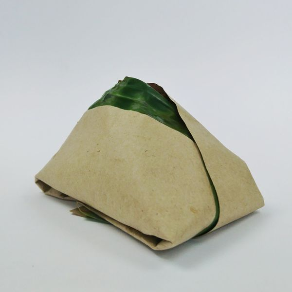 Tradisional fresh Malaysian Nasi Lemak packed with banana leaf in white background Food Stories Food Traditional Food Nasi Lemak Rice Paddy Rice Brekfast  Supper Eating No People White Background Close-up Day