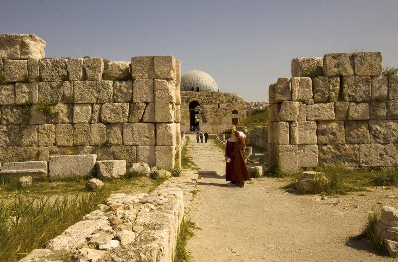 Women taking selfie against old ruins