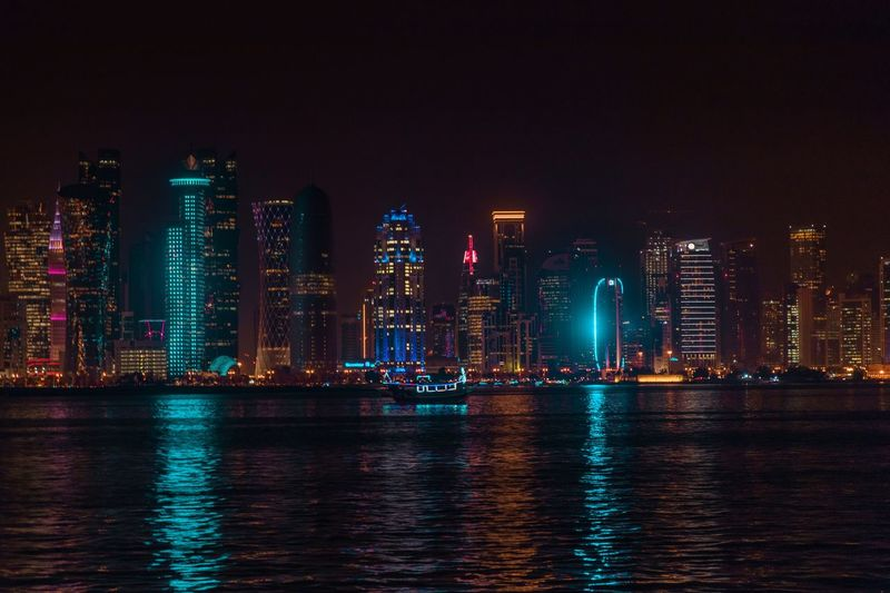 Qatar skyline Architecture Building Exterior Built Structure Night City Water Office Building Exterior Building Urban Skyline Illuminated Waterfront Landscape Skyscraper Cityscape Modern Sky Reflection No People Travel Destinations Tall - High