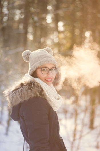 Beautiful Woman Beauty Cold Temperature Day Eyeglasses  Focus On Foreground Happiness Hat Knit Hat Leisure Activity Lifestyles Looking At Camera One Person Outdoors Portrait Real People Scarf Smiling Snow Tree Warm Clothing Winter Women Young Adult Young Women