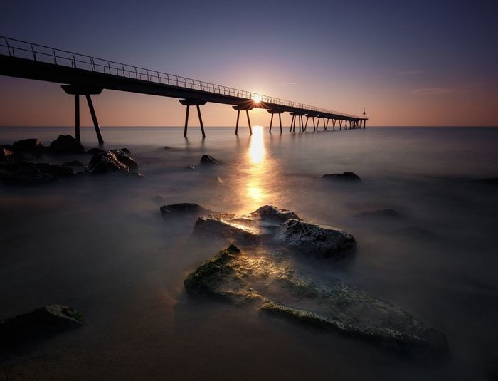 Sunset Water Built Structure Bridge - Man Made Structure Connection Sea Scenics Beauty In Nature Travel Destinations Nature No People Outdoors Horizon Over Water Sky Beach Day