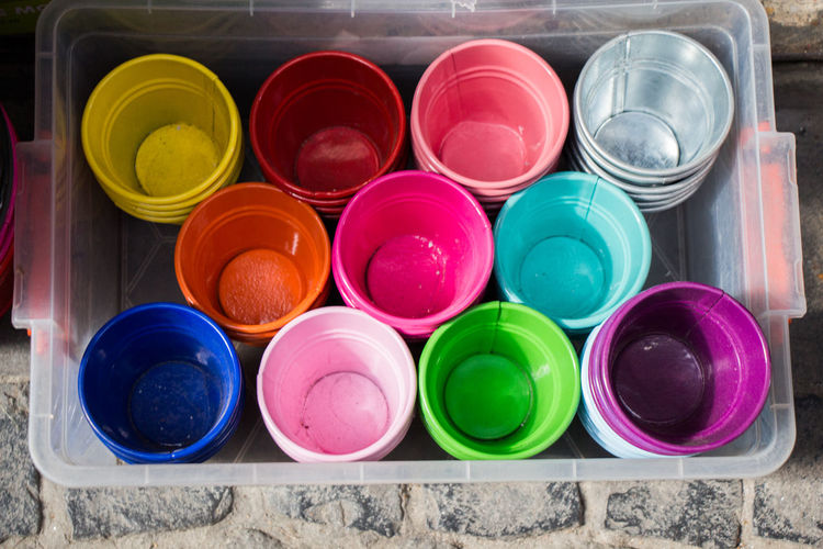 Set of colorful buckets in a box Container Aerosol Can Bucket Choice Close-up Colorful Container Day High Angle View Indoors  Large Group Of Objects Multi Colored No People Powder Paint Variation