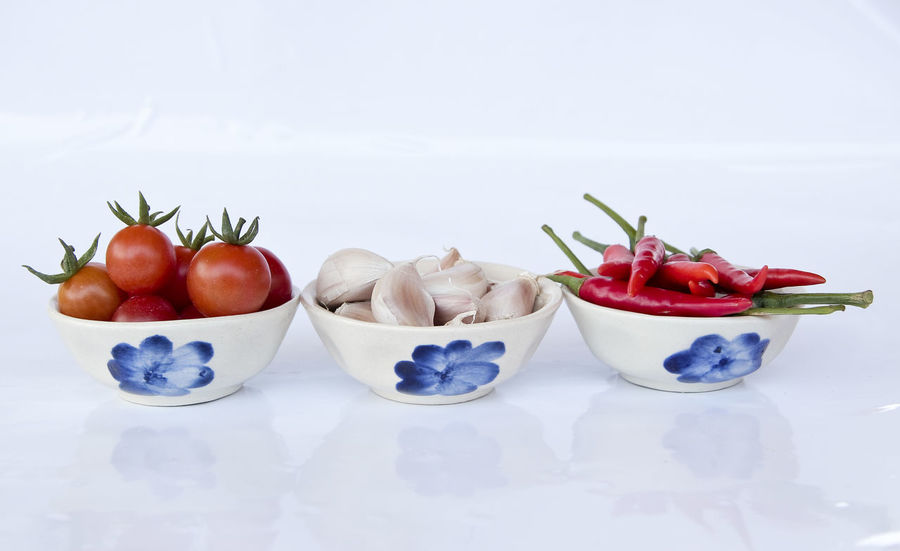 Close-up Cooking Copy Space Decoration Food Food And Drink Freshness Fruit Glass - Material Healthy Eating Indoors  Kitchen No People Organic Plate Red Red Hot Red Hot Chili Peppers Ripe Still Life Studio Shot Table Tomatoes Vegetable White Background