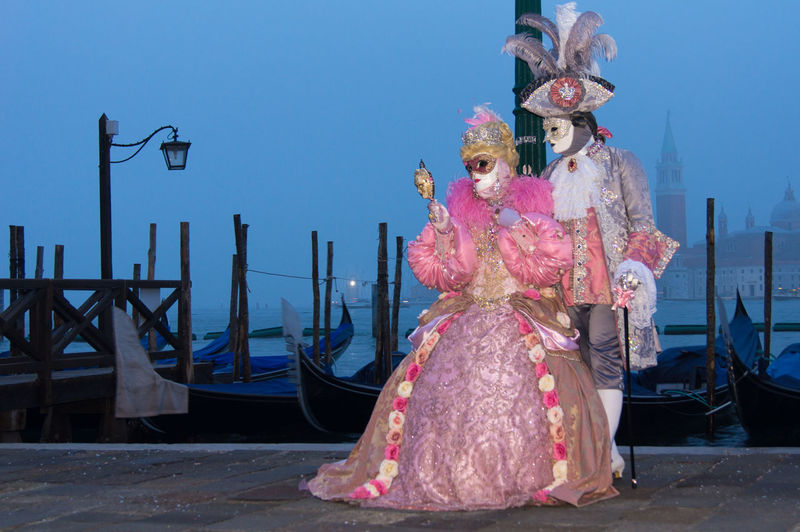 Carnival in Venice Carnival In Venice Architecture Clear Sky Costume Day Full Length Gondola - Traditional Boat Mask - Disguise One Person One Woman Only Outdoors People Pose Real People Sky Traditional Clothing Women The Street Photographer - 2018 EyeEm Awards The Portraitist - 2018 EyeEm Awards The Photojournalist - 2018 EyeEm Awards The Art Of Street Photography