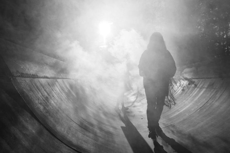 Silhouette Woman At Skateboard Park