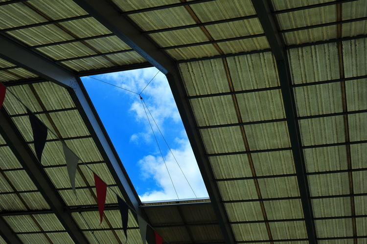 Architectural Feature Architecture Blue Built Structure Ceiling City Life Cloud Cloud - Sky Day Geometric Shape Looking Outside Low Angle View No People Sky Skylight Eyeem Photo The Color Of Sport