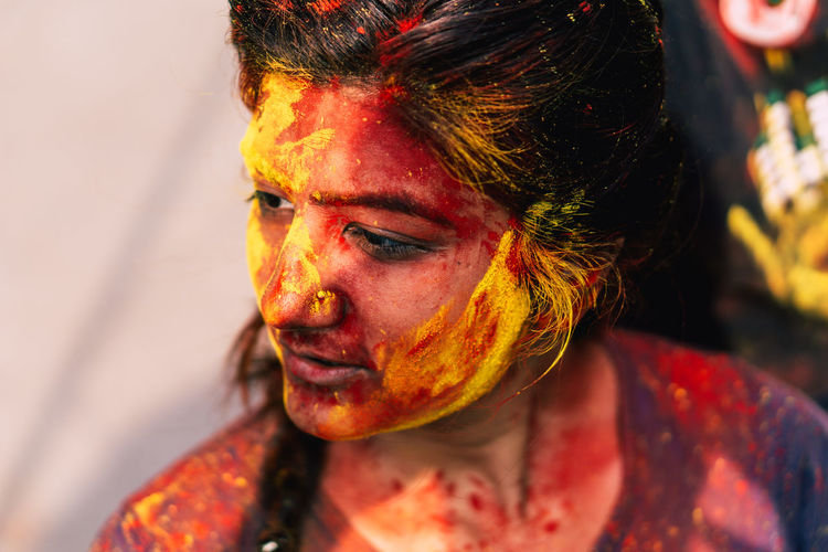 Close-up of woman covered with powder paint